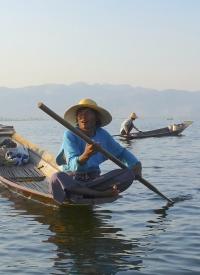 Fisherman looking at the horizon in Burma